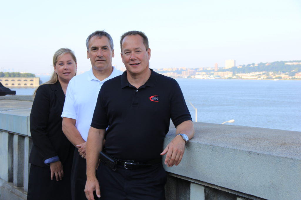 Left to right: Against the backdrop of the Hudson River are Devon Beaver, Distribution Sales Manager; Larry Flach, Executive Vice President; and John Beaver, President, GSA